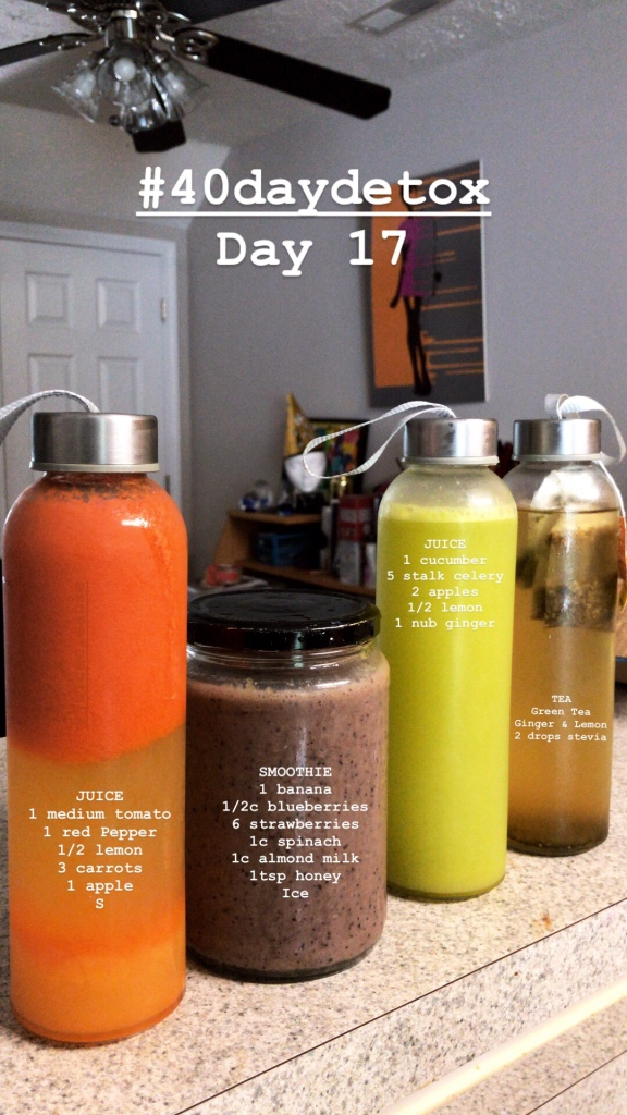 Glass bottles holding various fresh juices for a juice fast detox